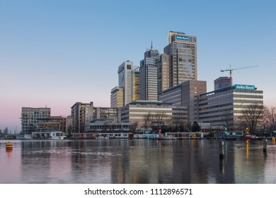 AMSTERDAM, THE NETHERLANDS - February 07, 2018: Breitner, Mondriaan and Rembrandt tower and CBD near the Amstel river at sun rise during a cold morning  in AMSTERDAM THE NETHERLANDS