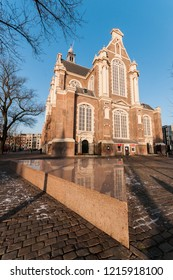 Amsterdam, The Netherlands - February 13, 2018: Part of the Homomonument monument in front of the Westerkerk church. A monument dedicated to all the homosexuals who were victims of persecution.