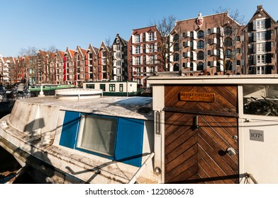 Amsterdam, The Netherlands - February 13, 2018: typical houseboat. In the past the houseboats were boats for freight transport. Now they have acquired a new use destination, becoming real houses