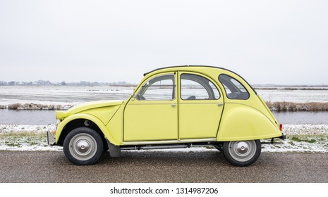 AMSTERDAM, NETHERLANDS - FEBRUARY 14, 2019: An oldtimer Citroën 2CV, also called Citroen Deudeuche, from 1976 in the original color yellow called Jaune Cedrat. The car is a 2CV4 and in mint condition