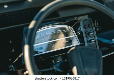 AMSTERDAM, NETHERLANDS - FEBRUARY 20, 2018: Dashboard, speedometer and steering wheel of a French oldtimer classic car vehicle and industrial design icon, the Citroen 2CV or Citroën 2CV
