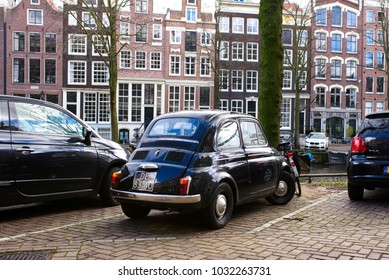 AMSTERDAM, NETHERLANDS - FEBRUARY 2018: black Fiat Nouva 500. An affordable car for every working family. Fiat started making them by the thousands and put all of Italy on wheels.