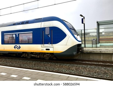 Amsterdam, Netherlands - February 23, 2017: Electric passenger train near platform in Amsterdam area