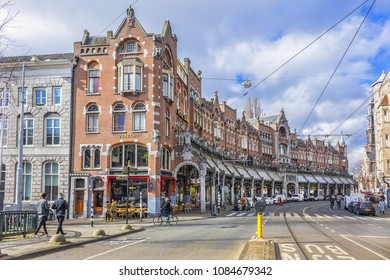 AMSTERDAM, NETHERLANDS - FEBRUARY 27, 2018: Old houses at Raadhuisstraat (1895) in Downtown Amsterdam. The street is named after the former Town Hall; it is the main thoroughfare into Old Centre.