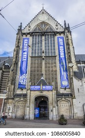 AMSTERDAM, NETHERLANDS - FEBRUARY 27, 2018: View of the Nieuwe kerk (New church) located on Dam square, next to Royal Palace. The building used for exhibition, organ recitals and as museum.
