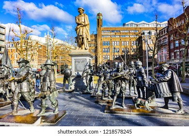 """AMSTERDAM, NETHERLANDS - FEBRUARY 27, 2018: View of famous Rembrandt van Rijn monument and sculptures of his picture """"The Night watch"""" on Rembrandtplein (Rembrandt Square) in Amsterdam."""