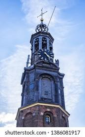 AMSTERDAM, NETHERLANDS - FEBRUARY 27, 2018: Amsterdam Mint Tower (or Munttoren, 1620) at Muntplein square near flower market. Munttoren was originally part of gate in Amsterdam's medieval city wall.