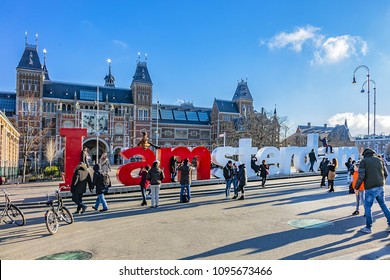 "AMSTERDAM, NETHERLANDS - FEBRUARY 28, 2018: Tourists at the famous sign ""I amsterdam"" at Museum Square near Rijksmuseum in Amsterdam."