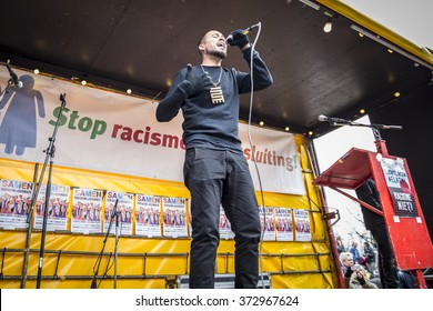 """Amsterdam, The Netherlands - February 6,2016: Dutch rapper Insayno parforming at public demonstration """"Refugees welcome, racism not!"""" to contest against racism and islamophobia named"""