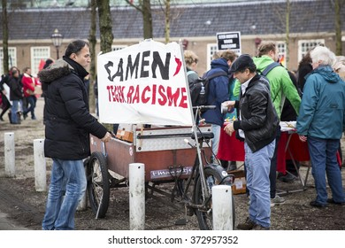 "Amsterdam, The Netherlands - February 6,2016: public multi-cultural demonstration to protest against racism and islamophobia named ""Refugees welcome, racism not!"" banner says together against racism"
