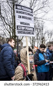 """Amsterdam, The Netherlands - February 6,2016: public multi-cultural demonstration organized to protest against racism and islamophobia named """"Refugees welcome, racism not!"""""""