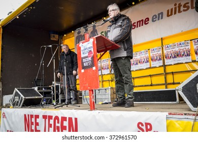"""Amsterdam, The Netherlands - February 6,2016: Speech from Max van den Berg from Auschwitz comity at public demonstration """"Refugees welcome, racism not"""" protesting against racism and islamophobia."""