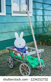 Amsterdam, the Netherlands - FEBRUARY 8, 2018: A white Miffy sitting in a wood trolley.