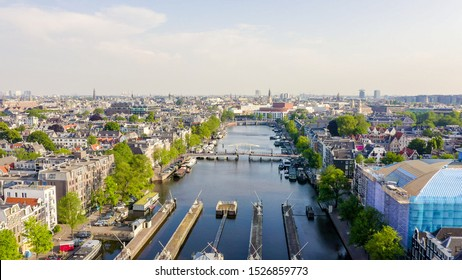 Amsterdam, Netherlands. Flying over the city rooftops. Amstel River, Amstel Gateways, Aerial View