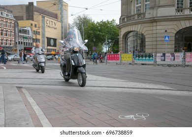 Amsterdam, The Netherlands - Friday, August 11, 2017 - Scooters on city streets of Leidseplein/Leidsebuurt area