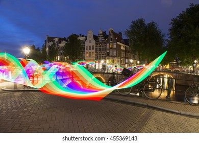 Amsterdam, The Netherlands - Friday, July 15, 2016 - Long exposure photo at night with rainbow light painting. Amsterdam Gay Pride. Europride 2016.