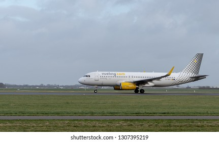 AMSTERDAM / NETHERLANDS - JAN 08, 2019: Vueling Airbus A320-232 EC-MKM passenger plane taking off from Amsterdam Schiphol Airport