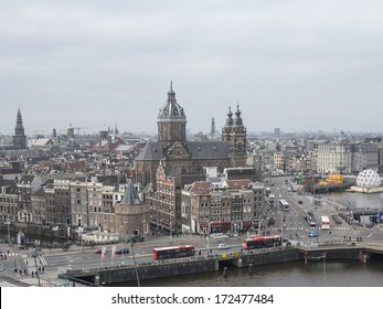 AMSTERDAM, NETHERLANDS - JAN 18,2014:View on the historic city centre of Amsterdam. The country's largest city is visited by over 3,5 million foreign tourists a year.