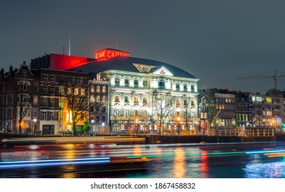 Amsterdam, The Netherlands ,  Jan 2020 - Carre Royal theater long exposure shot wtih light trail along the canal