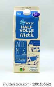 Amsterdam, the Netherlands - Januari 31, 2019: AH 1,5 liter semi-skimmed milk package against a white background.