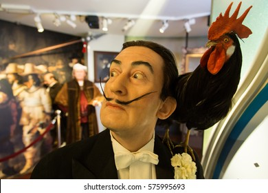 AMSTERDAM, NETHERLANDS - January 08, 2017: Salvador Dali and a rooster, Madame Tussauds wax museum in Amsterdam. One of the popular touristic attractions