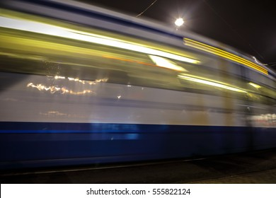 AMSTERDAM, NETHERLANDS - JANUARY 09, 2017: Blurred silhouette of moving tram in Amsterdam city at night. January 09, 2017 in Amsterdam - Netherland.