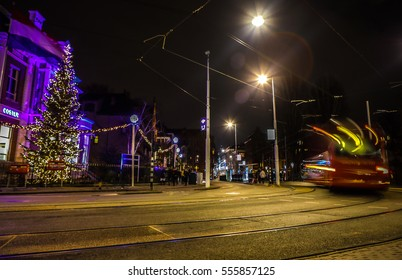 AMSTERDAM, NETHERLANDS - JANUARY 09, 2017: Amsterdam city road with different kinds moving transport at night. January 09, 2017 in Amsterdam - Netherland.