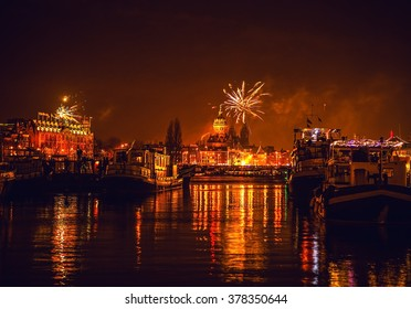 AMSTERDAM, NETHERLANDS - JANUARY 1, 2016: Festive salute of fireworks on New Year's night. On January 1, 2016 in Amsterdam - Netherland.