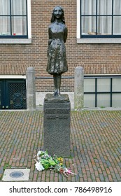 Amsterdam, The Netherlands, January 1, 2018: Anne Frank statue located on Westerkerk Plaza near the Anne Frank House. Anne Frank is famous for her wartime diary.