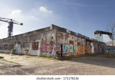 Amsterdam, Netherlands - January 10, 2014: Graffiti on the wall in NSDM Wharf in Amsterdam on 10th of January 2014