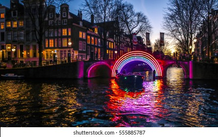 AMSTERDAM, NETHERLANDS - JANUARY 10, 2017: Light installations on night canals of Amsterdam within Light Festival. January 10, 2017 in Amsterdam - Netherland.