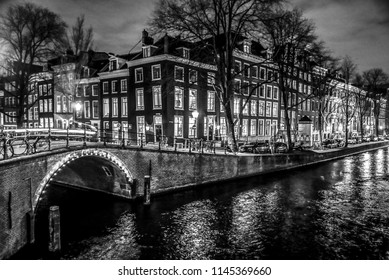 AMSTERDAM, NETHERLANDS - JANUARY 11, 2017: Beautiful night city canals of Amsterdam. January 11, 2017 in Amsterdam - Netherland.