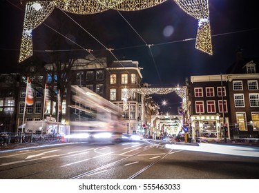 AMSTERDAM, NETHERLANDS - JANUARY 11, 2017: Headlights car passing down street at night. Time Lapse. January 11, 2017 in Amsterdam - Netherland.