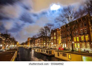 AMSTERDAM, NETHERLANDS - JANUARY 12, 2017: Beautiful night city canals of Amsterdam. on January 12, 2017 in Amsterdam - Netherland.