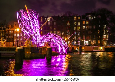 AMSTERDAM, NETHERLANDS - JANUARY 12, 2017: Light installations on night canals of Amsterdam within Light Festival. January 12, 2017 in Amsterdam - Netherland.
