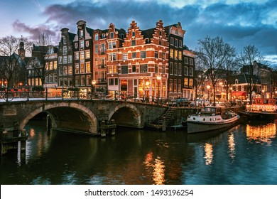 Amsterdam, Netherlands - January 14, 2019: Beautiful canal houses on the corner of Brouwersgracht and Prinsengracht in the old center of Amsterdam in The Netherlands during sunset