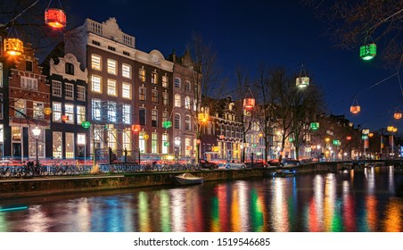 Amsterdam, Netherlands - January 14, 2019: Light Festival Amsterdam,  colorful lanterns above the Herengracht in the old town of Amsterdam
