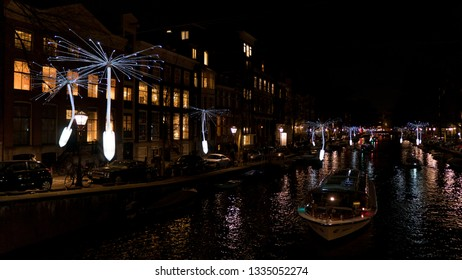 Amsterdam, Netherlands - January 19, 2019:  the 7th edition of the Amsterdam Light Festival. During winter there are light artworks lighting up the dark nights of the Amsterdam city centre.