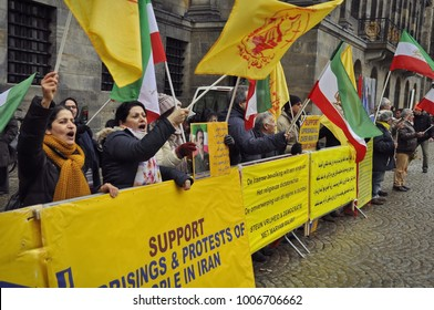 Amsterdam, Netherlands - January 20, 2018: Supporters of the uprising in Iran protesting with national flags in front of the royal palace on the Dam Square