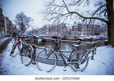 AMSTERDAM, NETHERLANDS - JANUARY 22, 2019: Winter Wonder Land in the Dutch Capital Amsterdam with very rare snowfall on the dutch bikes and canals