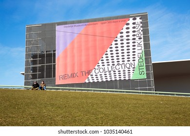 AMSTERDAM, THE NETHERLANDS - JANUARY 25th, 2018. Facade of the museum of modern art 'Stedelijk Museum' in Amsterdam and their permanent base collection. Shot against a blue sky.