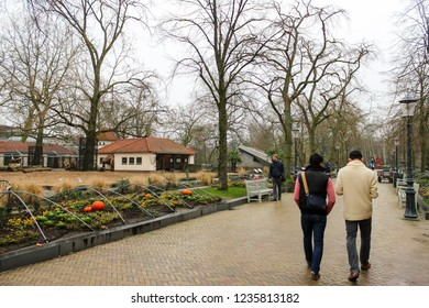 AMSTERDAM, NETHERLANDS - January 3, 2018 : Unidentified tourists walking in Artis Zoo in Amsterdam.