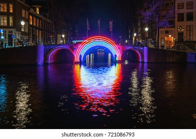 Amsterdam, Netherlands, January 5, 2017: Illuminated bridge in the old town during the Festival of Light in Amsterdam