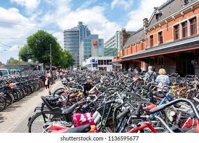 AMSTERDAM, NETHERLANDS - JUL 13: Thousands of bicycles parked outside the main train station in Amsterdam, Netherlands on July 13, 2018. Bicycles are the most popular transport for the country's peopl