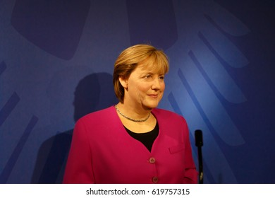AMSTERDAM, NETHERLANDS - JULY 02, 2016 : Angela Merkel figure in Madame Tussauds Wax Museum in Amsterdam. Madame Tussauds Museum is one of the most popular attraction in Netherlands.