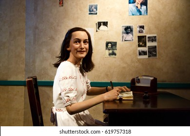 AMSTERDAM, NETHERLANDS - JULY 02, 2016 : Anne Frank figure in Madame Tussauds Wax Museum in Amsterdam. Madame Tussauds Museum is one of the most popular attraction in Netherlands.