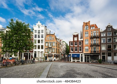 Amsterdam, Netherlands - July 03 2016: The traditional Dutch houses on Singel street, morning time