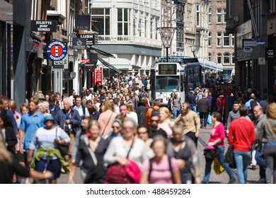 Amsterdam, Netherlands - July 03 2016: Crowd the streets of the city at summer time