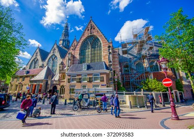 Amsterdam, Netherlands - July 10, 2015: Oude Kerk, famous church in cuty centre, beautiful facade of glass and bricks
