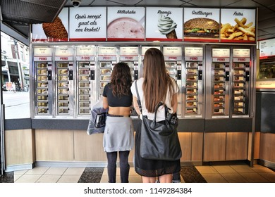 AMSTERDAM, NETHERLANDS - JULY 10, 2017: Customers choose their fast food in Febo in Amsterdam. Febo is a popular self service Dutch fast food chain specializing in croquettes and burgers.